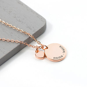 Personalised rose gold plated necklace with a disc that can be engraved with a name or message of your choice and a small heart charm next to it. The necklace comes with a rose gold plated necklace.