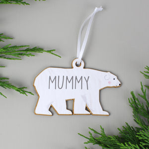 Personalised adult polar bear decoration as part of a family set of two adults and two baby bears. Each bear is painted white and can be personalised with a name of up to 12 characters which will be printed on each bear in a modern grey uppercase font.