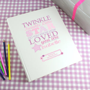 Personalised photo album with the text 'twinkle twinkle little star do you know how loved you are' printed on the front cover in various fonts and sizes in different shades of pink. The cover can be personalised with a name and message or celebration details of your choice. Internally the album has approximately 30 pages interleafed with tissue.
