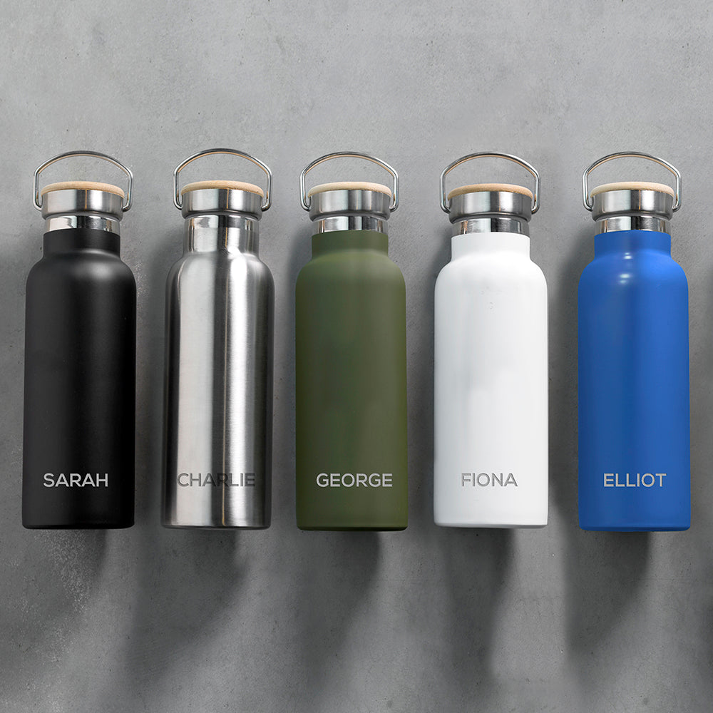 Personalised insulated drinks bottles with bamboo vacuum sealed lids and a carry handle available in matt black, stainless steel, matt green, matt white and matt blue. The bottle can be personalised with a name of your choice which will be engraved in uppercase.