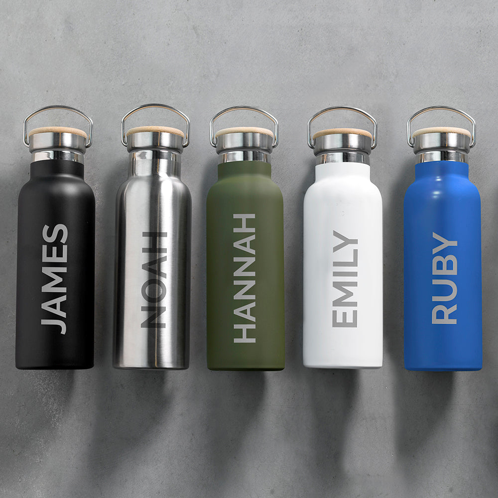 Personalised insulated drinks bottles in matt black, stainless steel, matt green, matt white and matt blue. Each bottle has a leak proof bamboo vacuum sealed lid and a carry handle. The bottles can be personalised in a name of your choice which will be printed down the side of the bottle in large uppercase letters.