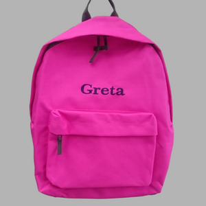 Personalised school rucksack in fuchsia pink with grey zips and trim with our traditional font choice. The rucksack is embroidered with a name of your choice in a colour of your choice.