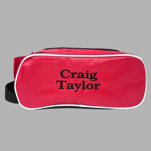 Personalised shoe bag for adults and children which can be personalised with a name which will be embroidered onto the front of the bag The bag is available in red with a white and black trim as pictured, royal blue with a white and black trim, navy or black.