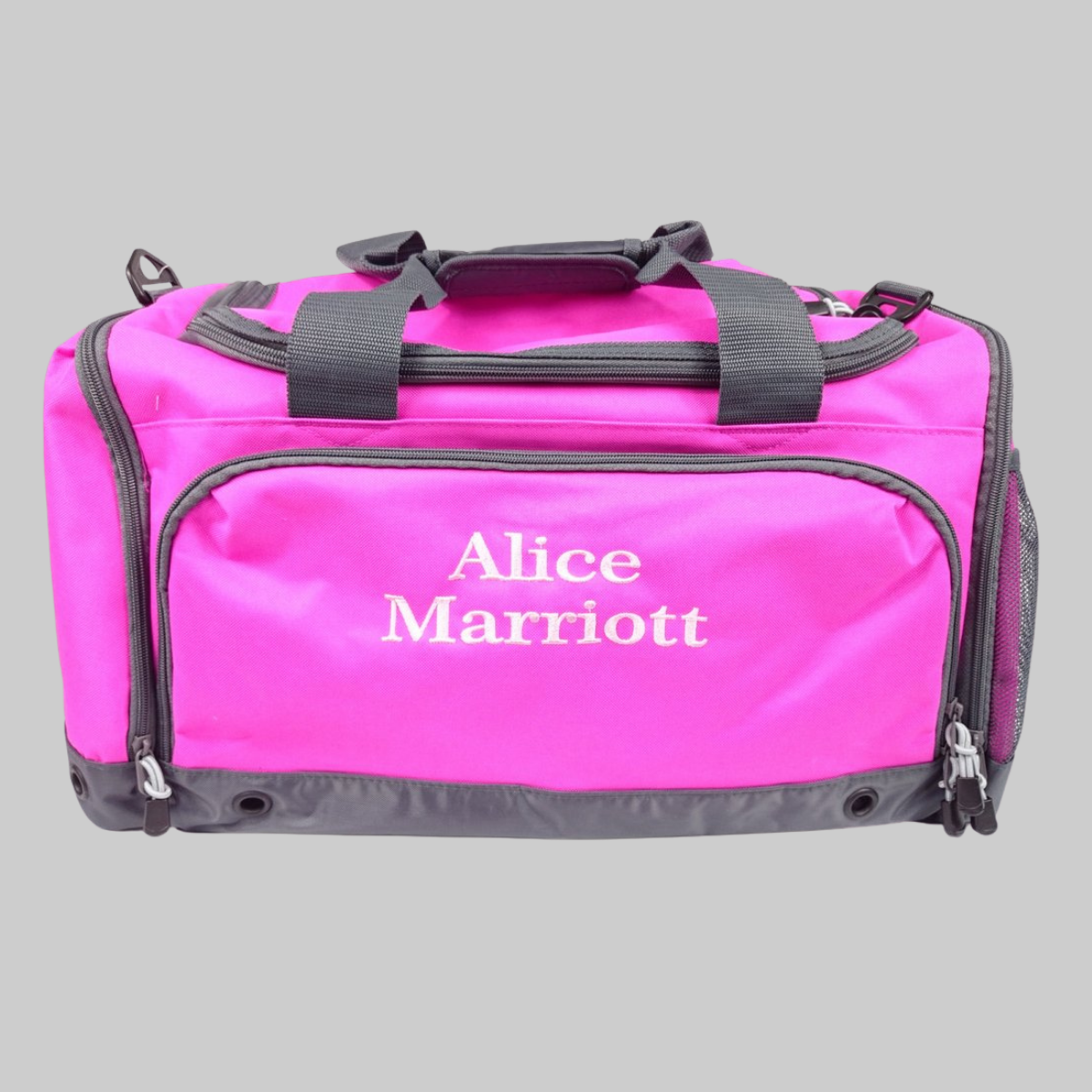 Personalised sports holdall for adults and children. The holdall features compartments to keep wet or mucky kit separate from the rest of your bag's contents. The bag can be personalised with a name of your choice and is avaiable in red, black, royal blue, lime, orange and fuschia pink.