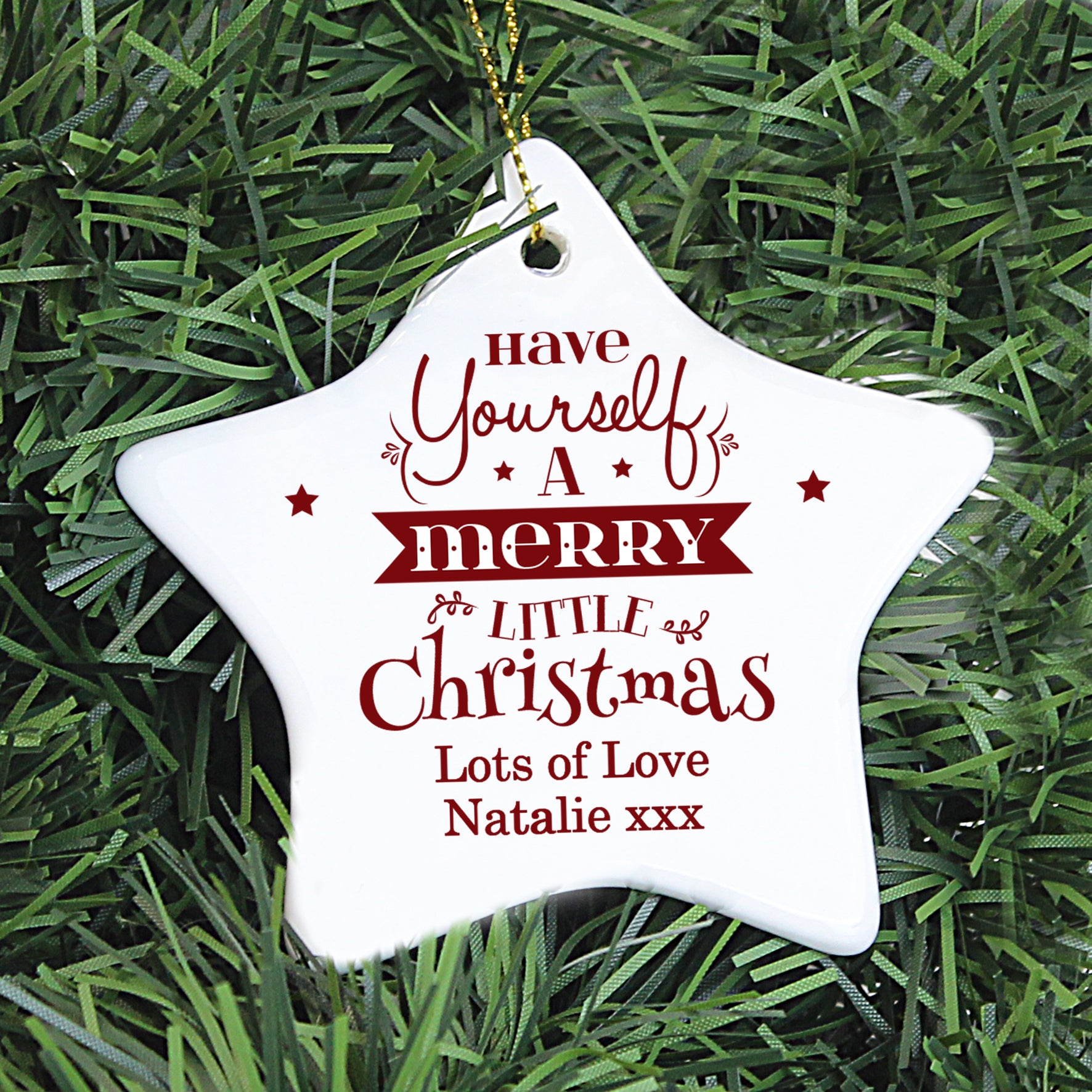 Personalised white ceramic star shaped Christmas decoration which can be hung on a tree. The decoration has 'Have yourself a merry little Christmas' printed on it in a mixture of upper and lower case fonts in red. Below this you can add your own special message over 1 or 2 lines which will also be printed in red.
