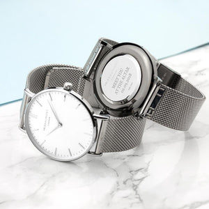 personalised mr beaumont watch with metallic silver mesh strap and white dial engraved with serif font