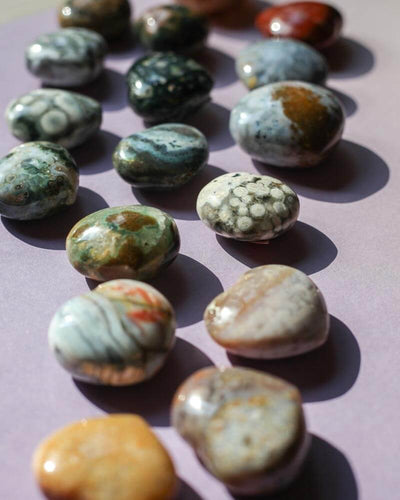 Ocean jasper hearts in the sun on a pink background