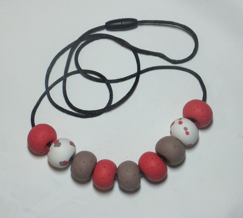 Necklace in Beige and Red beads imprinted with naughts and crosses and finished with two White beads with Red and Beige spots by LillyMay