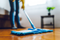 Blue Mop Cleaning Floors