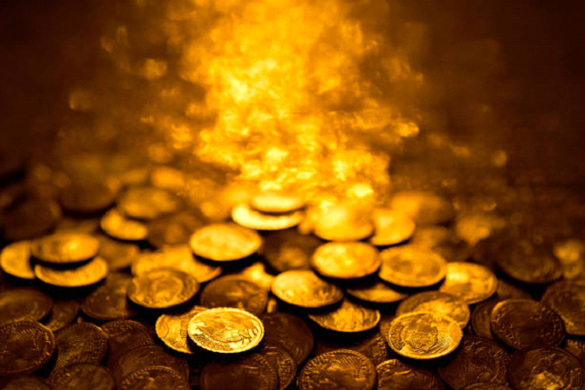gold coins in water