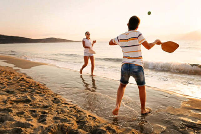 playing tennis at the beach