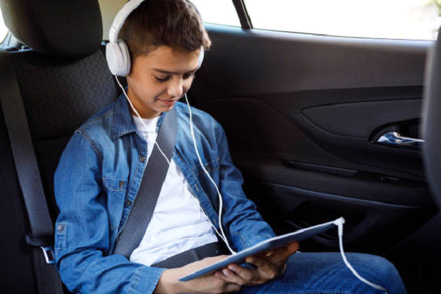 kid watching a movie in car