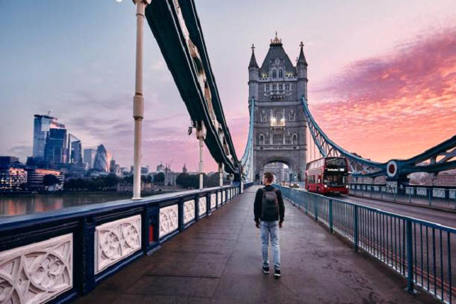 Man Walking in london beautiful night sky