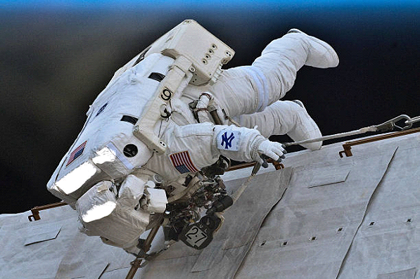 astronaut working on space shuttle