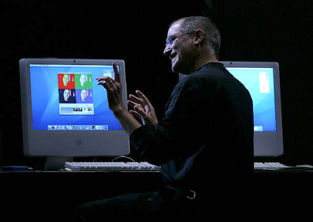 steve jobs in front of old computers