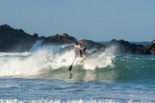 surfing with a paddle