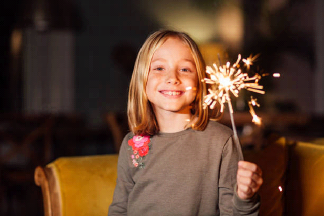 kid with sparkler
