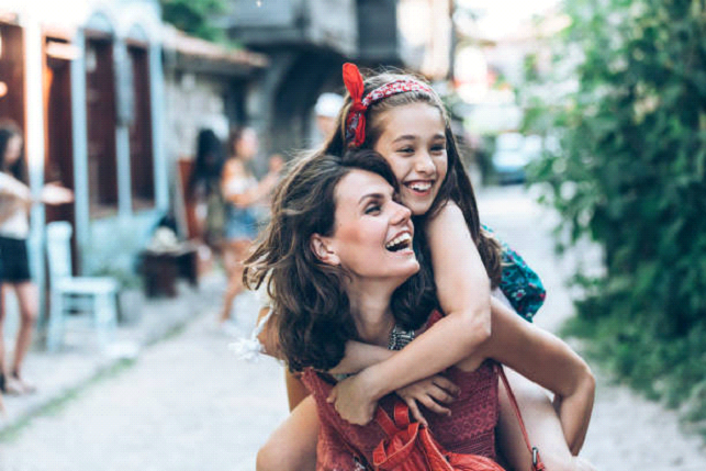 happy mother and daughter traveling
