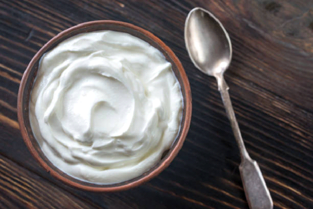greek yogurt with spoon photo