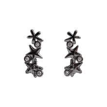 Load image into Gallery viewer, Black rhodium-plated earrings, featuring three beautiful starfishes with three clear zirconias stones. Anchoring: traditional screw (push back).