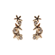 Load image into Gallery viewer, Gold earrings, featuring three beautiful starfishes with three clear zirconias stones. Anchoring: traditional screw (push back).