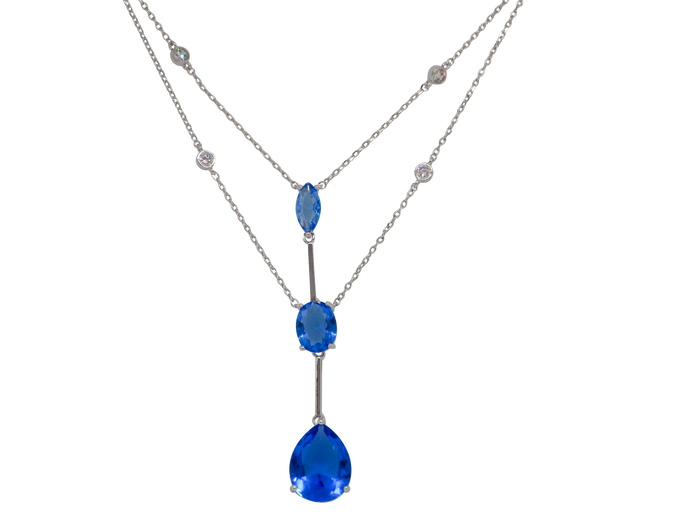 Necklace with double white rhodium-plated chain, there are three pendant royal blue zirconias stones connected by straight cable.