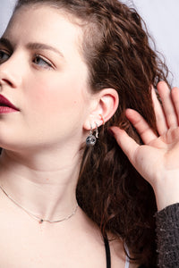 redheaded woman wearing a silver-toned, white rhodium-plated chain with a cubic zirconia spot