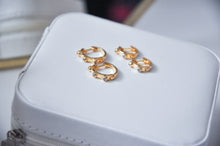 Load image into Gallery viewer, Two pairs of Spike cubic zirconias hoop earring on top of a jewellery box