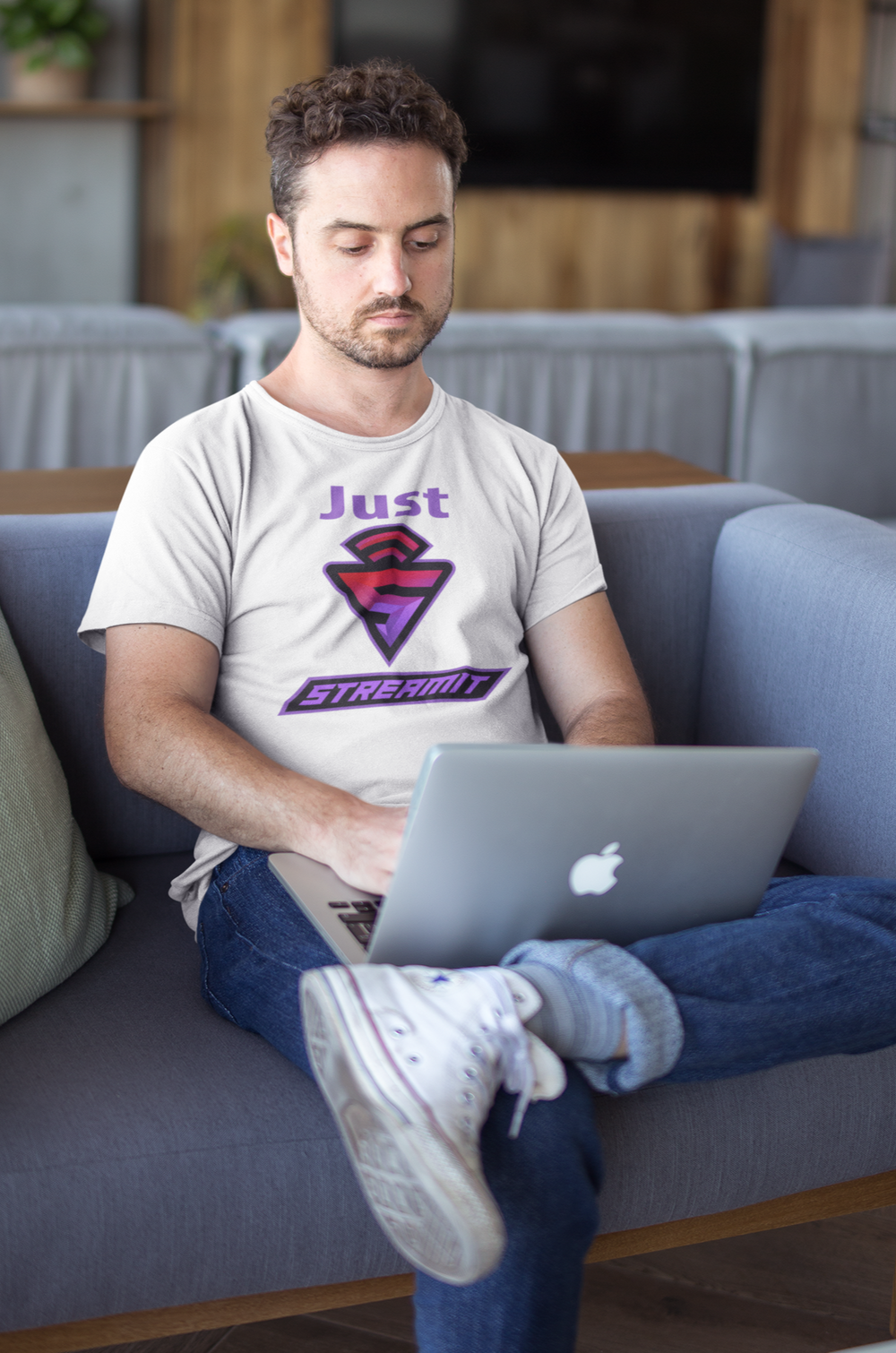 man sitting on couch with computer working on crypto