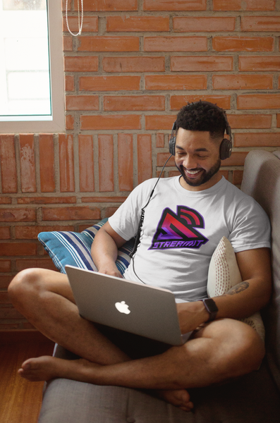 man on couch with computer and headphones working on cryptocurrency