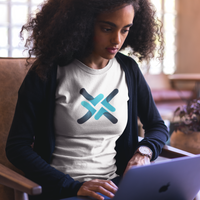 woman sitting on couch at office working on computer wearing a trittium cryptocurrency shirt