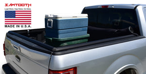 silver ford f150 with cooler in truck bed