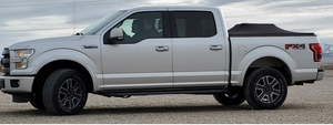 driving ford f150 silver with tonneau cover