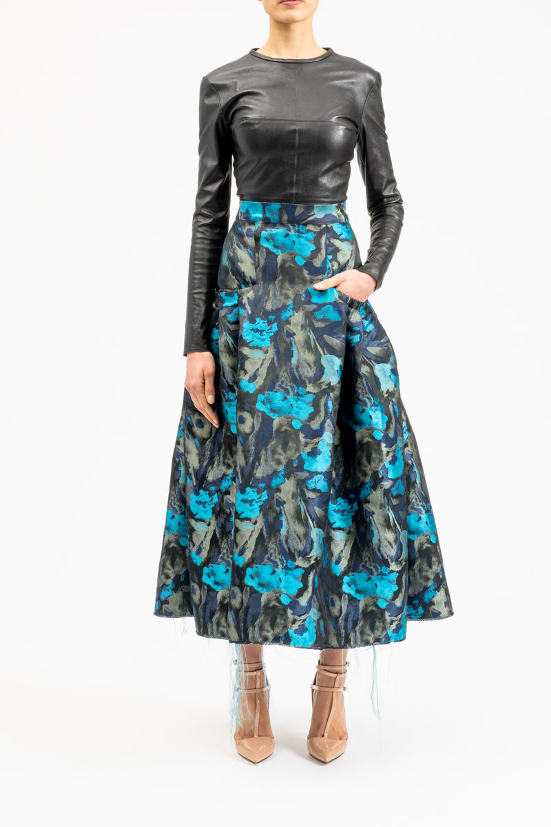Semi-circular ruffled skirt with flower applications