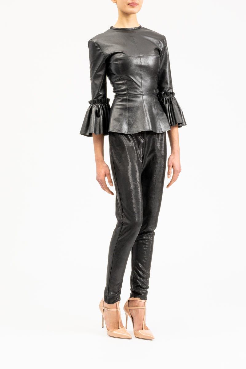 Black leather top with frilled cuffs