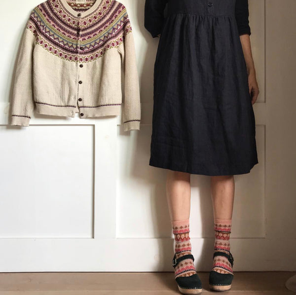 Black linen dress by California clothing designer Pyne & Smith styled with clogs