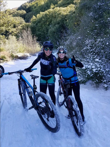 Pathletes Leslie Williams and Brooke McFerren (right) brave the elements on Harding Truck Trail in 2019.