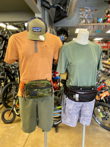 Patagonia mountain bike apparel and hydration packs on mannequins at our Tustin store.