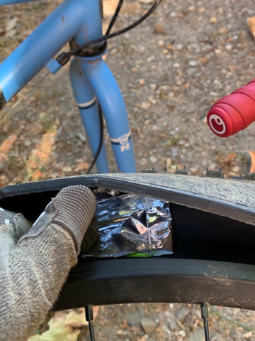 Booting a tire with a nutrition wrapper.