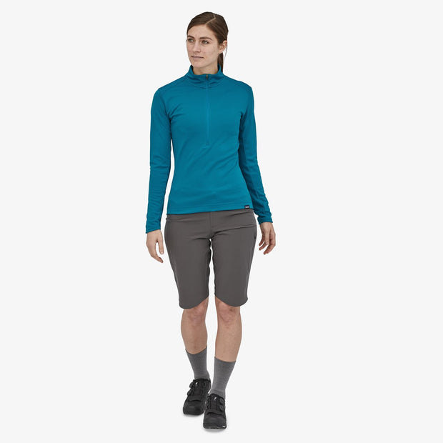 Patagonia Women's Capilene Midweight Bike Jersey steller blue on-model in motion view