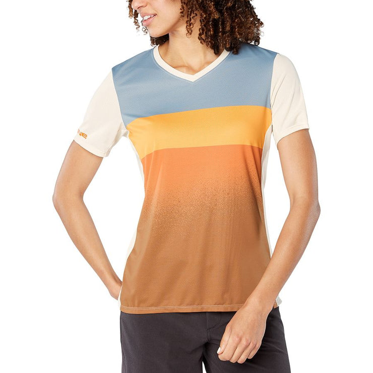 Dakine Women's Cadence Mountain Bike Jersey Desert sun on model