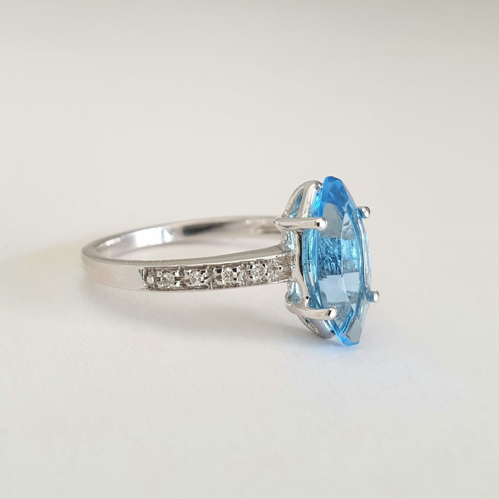 Marquise Cut Blue Topaz White Gold Ring with Diamond Accented Band