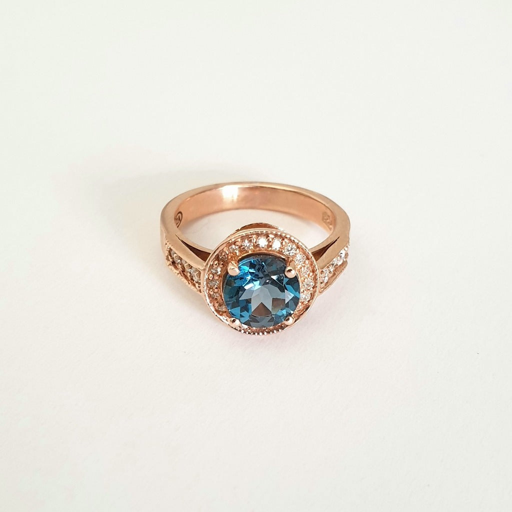 Rose Gold London Blue Topaz Ring with Diamond Halo and Band Accents