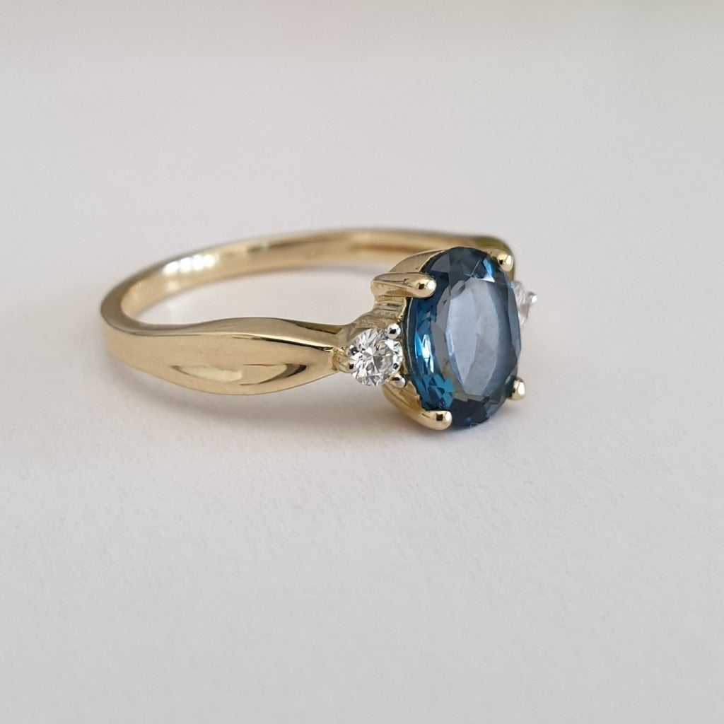 Oval-Cut London Blue Topaz Ring with Diamond Accents