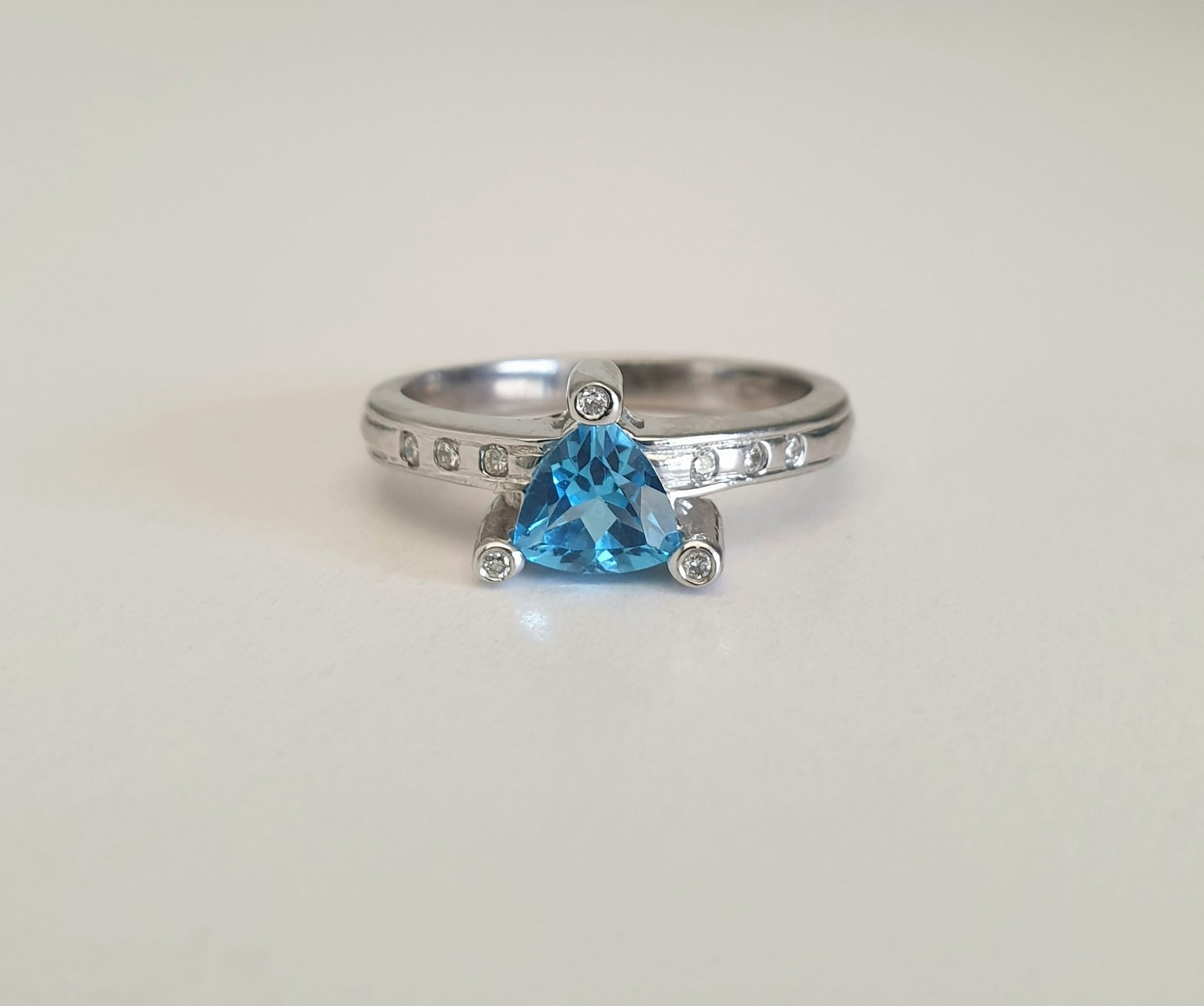 Trilliant Cut Blue Topaz With Diamond Point Accents
