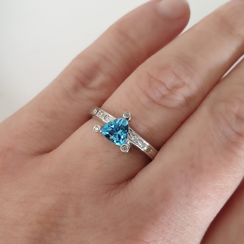 Trilliant Cut Blue Topaz With Diamond Point Accent