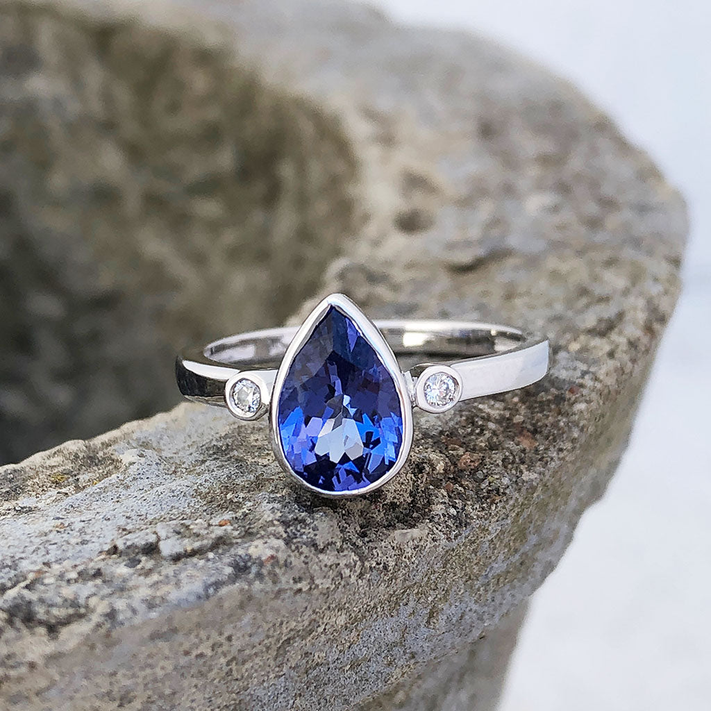 Bezel Set Pear Cut Tanzanite and Diamond Ring