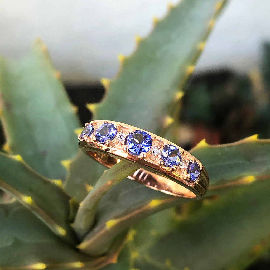 Contemporary Five Tanzanite and Four Diamond Rose Gold Ring