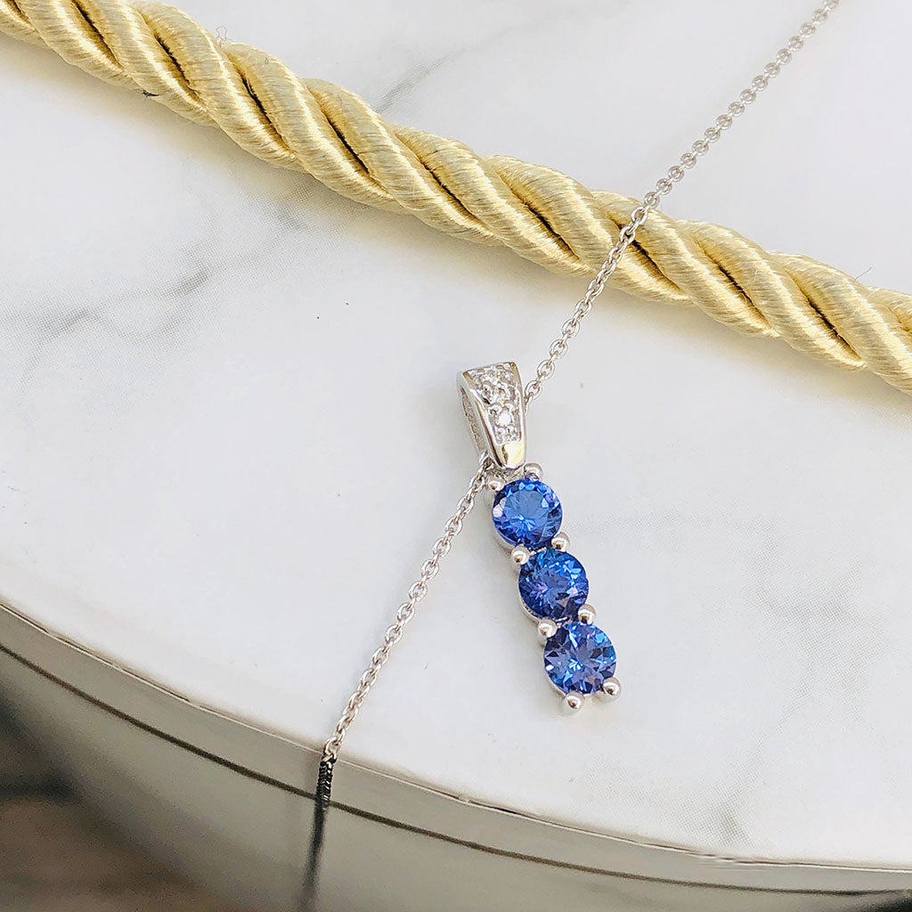 Diamond Bale and Three Round Cut Tanzanite Pendant
