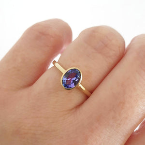 Elegant Oval Cut Bezel Set Solitaire Tanzanite Ring